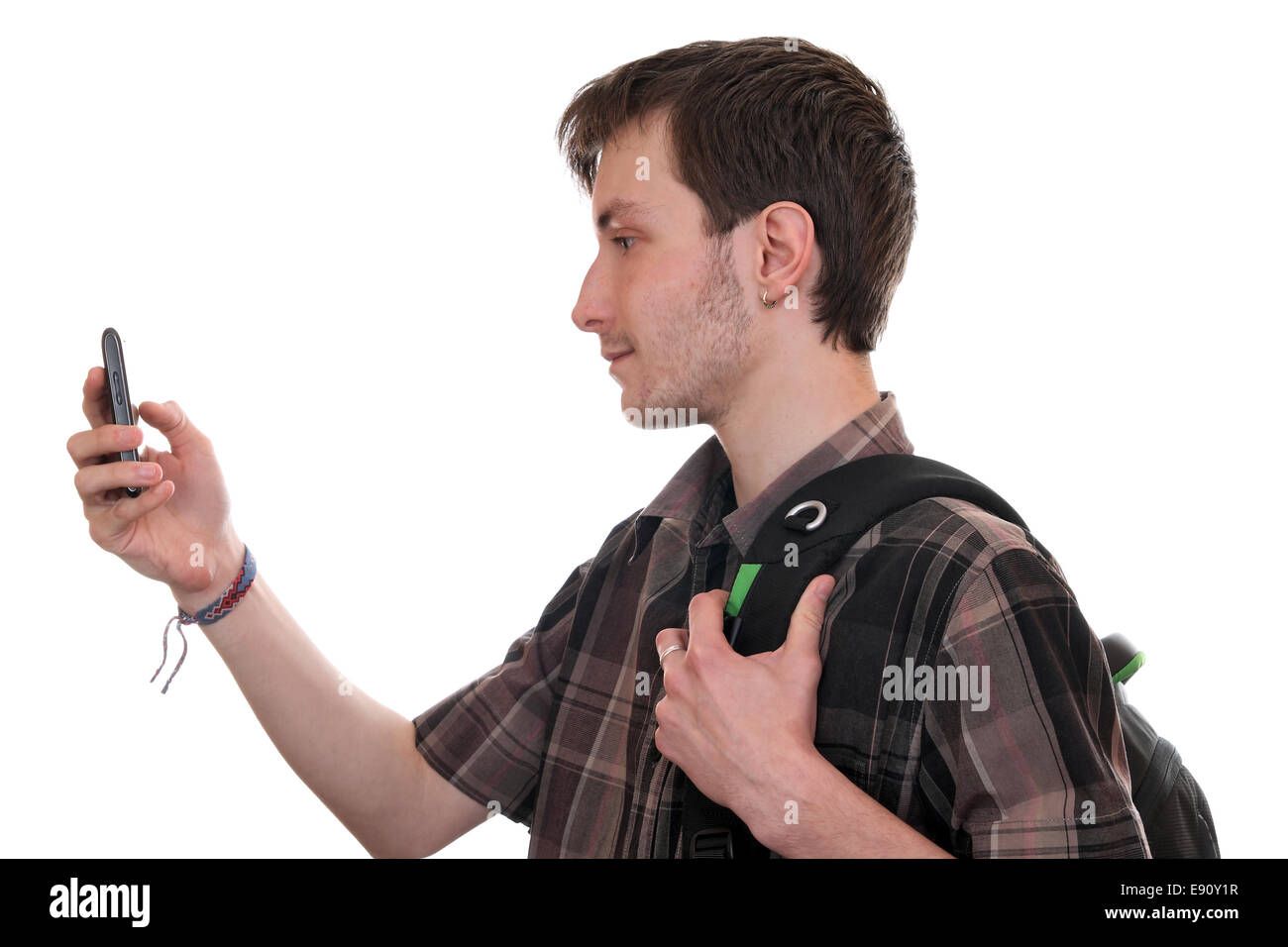 Young adult talking to friends on the PDA - Stock Image