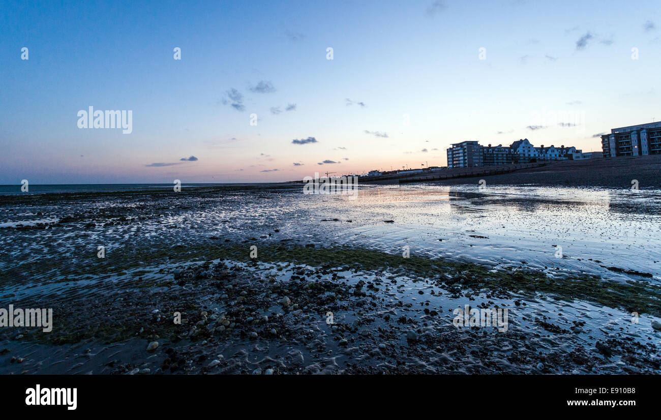 Low tide and twilight in Worthing, Wet Sussex, UK - Stock Image