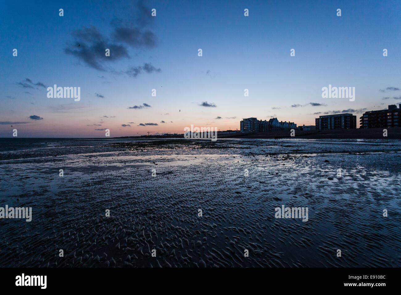 Low tide and twilight in Worthing, West Sussex, UK - Stock Image