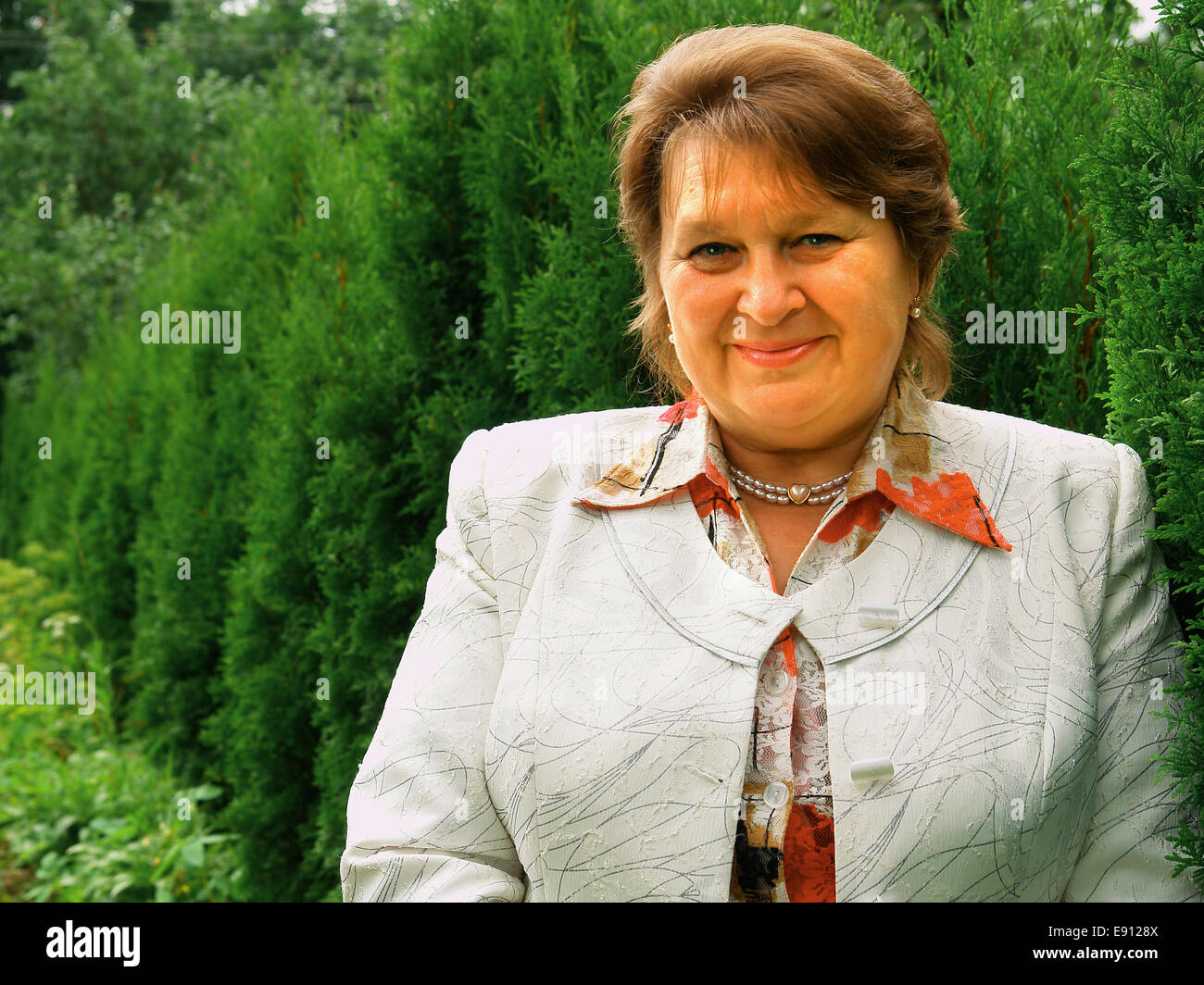 Mature business woman smiling confidently Stock Photo