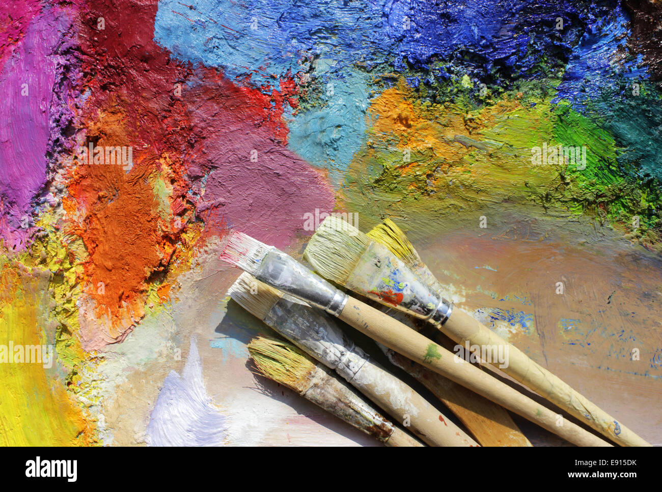 paint brushes on a palette - Stock Image