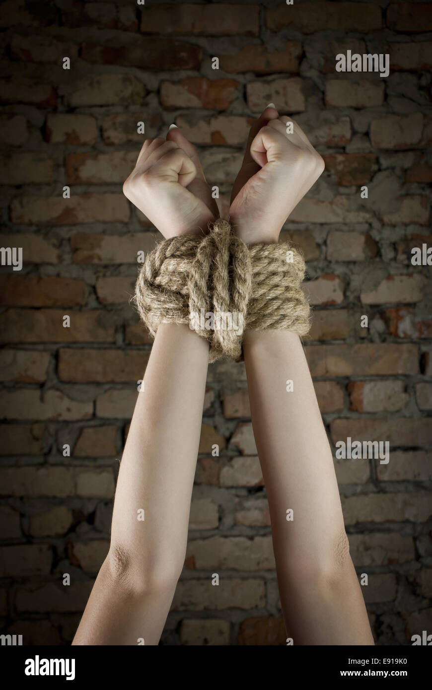 Hands tied above head