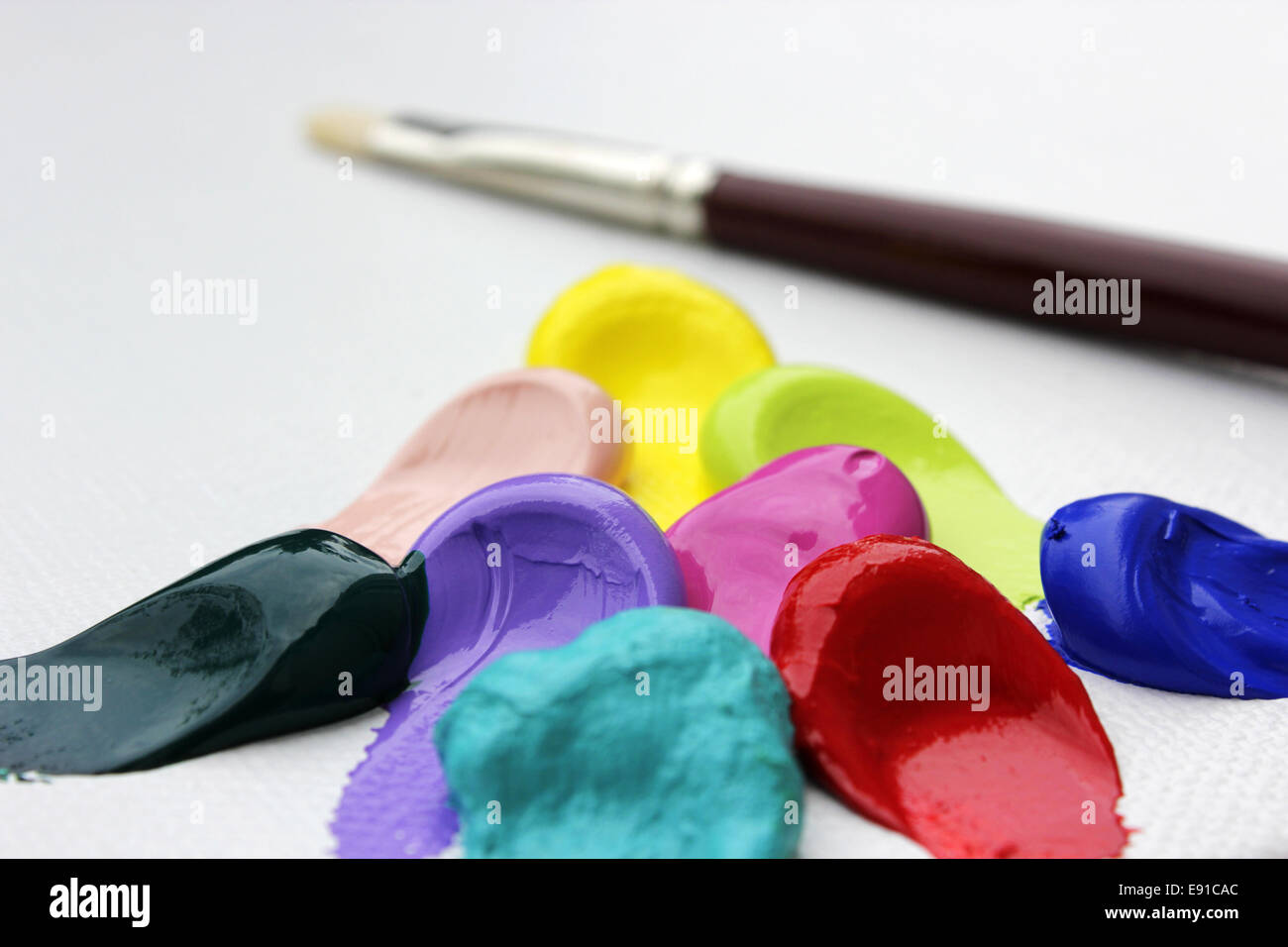 acrylics and paint brush - Stock Image
