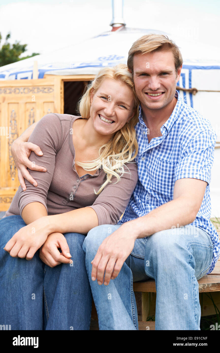 Couple Enjoying Camping Holiday In Traditional Yurt - Stock Image