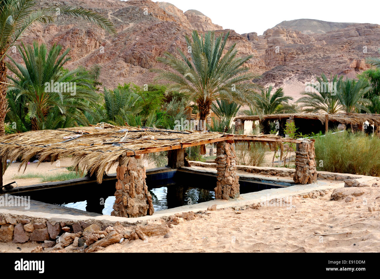 Water storage tanks at Ain Hudra (or Ayun Khodra) Oasis in south Sinai desert a Bedouin camp, Egypt - Stock Image