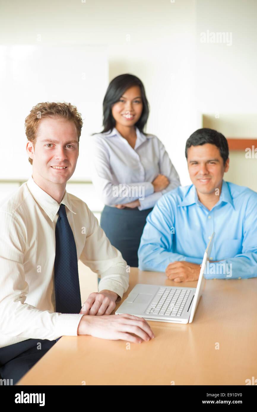 Caucasian Businessman Led Diverse Meeting - Stock Image