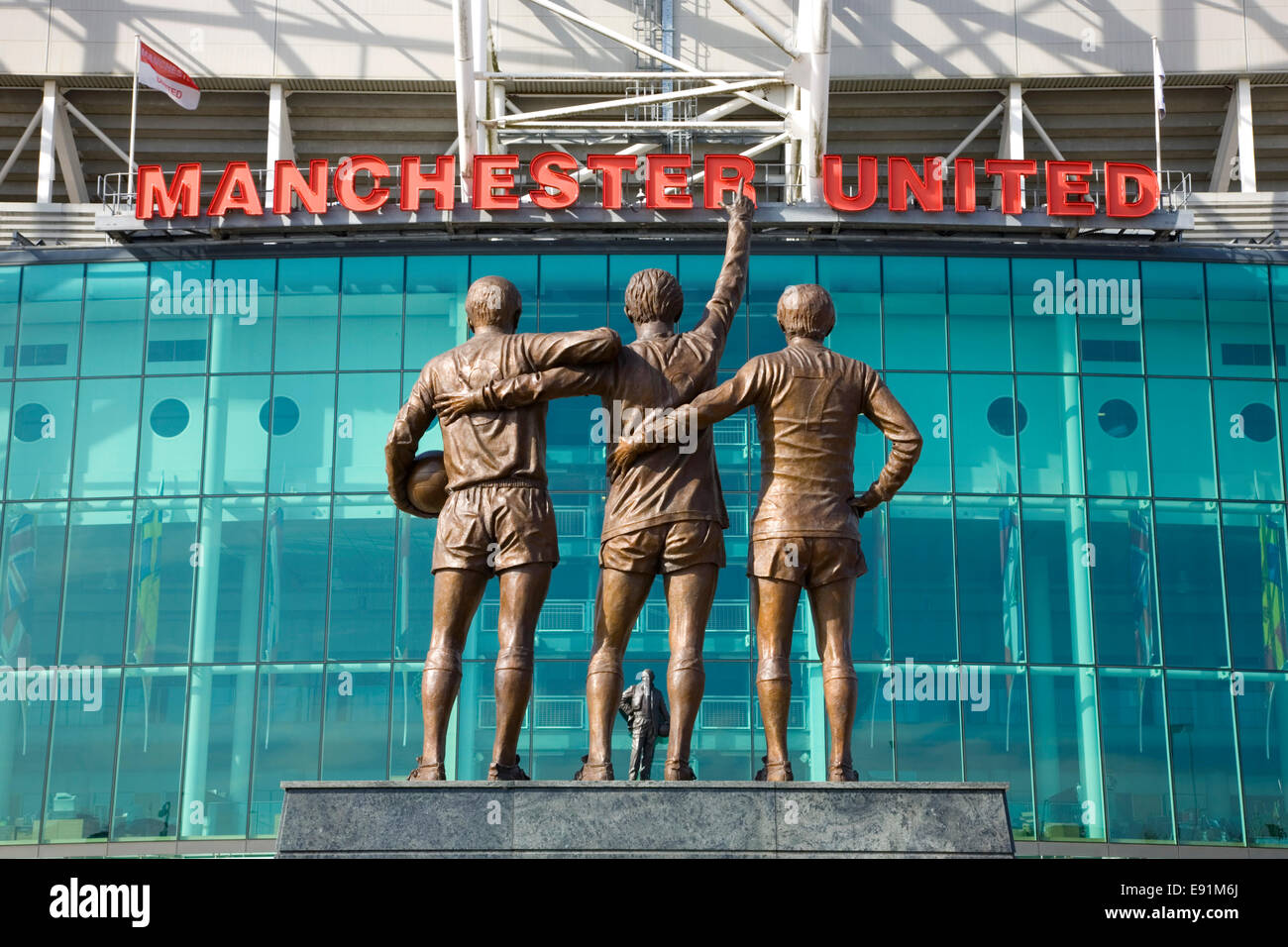 Old Trafford, Manchester, Greater Manchester, England. United Trinity statue outside the Manchester United football - Stock Image