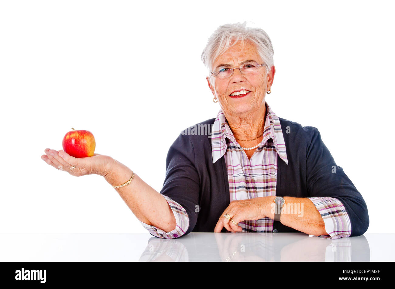 pensioner with apple Stock Photo