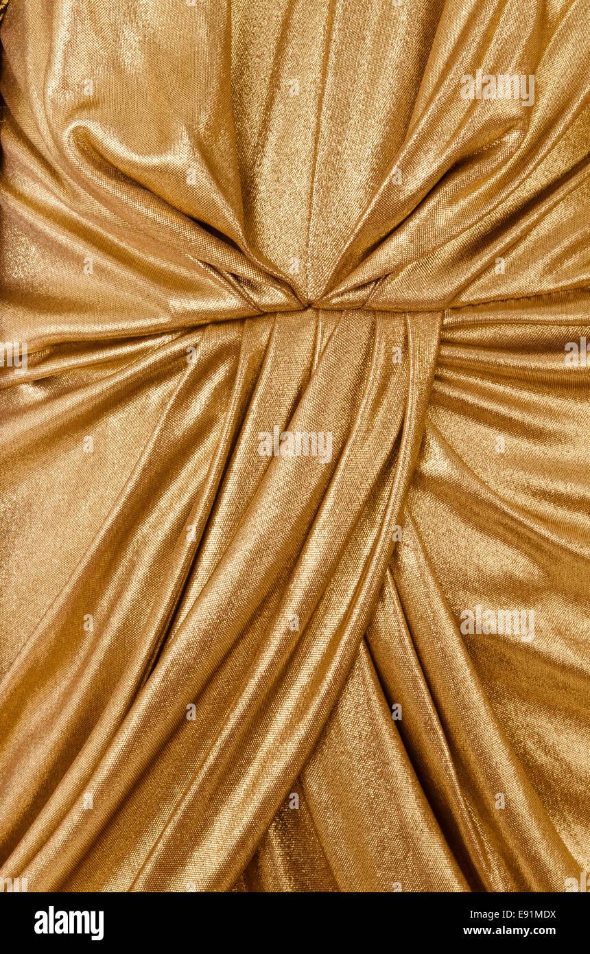 folds gold fabric closeup - Stock Image