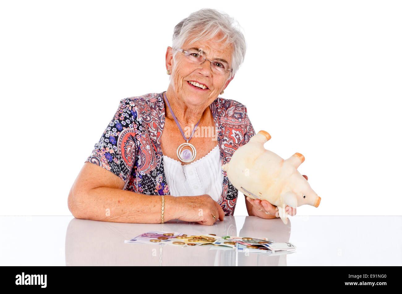 Senior woman with savings Stock Photo