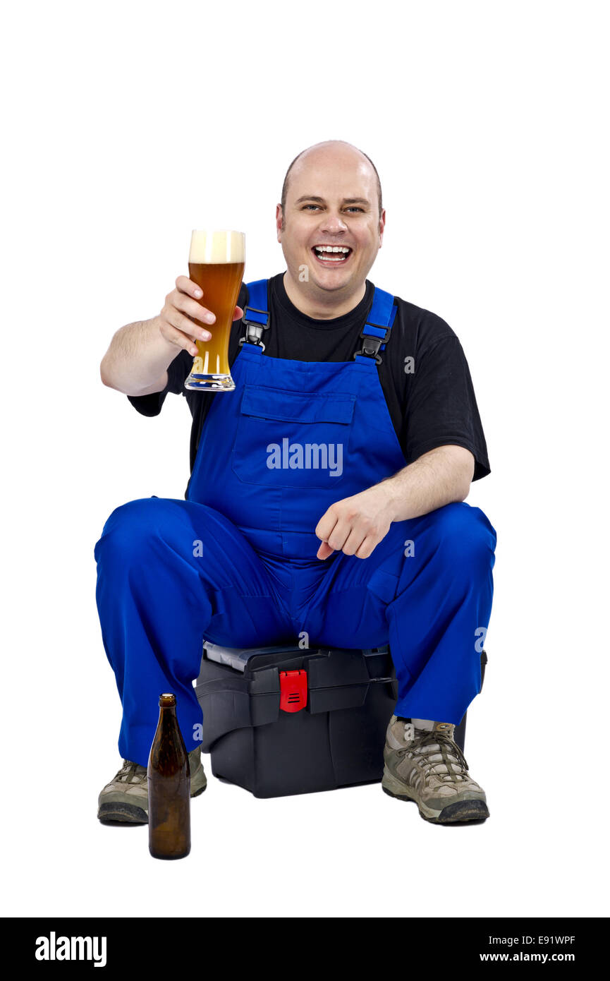 Craftsman with a beer in the evening - Stock Image