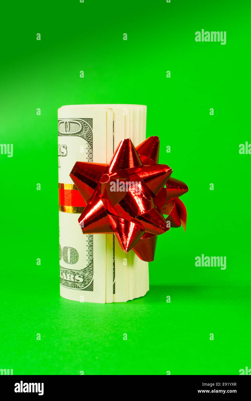 A wad of US one hundred dollar bills - Stock Image