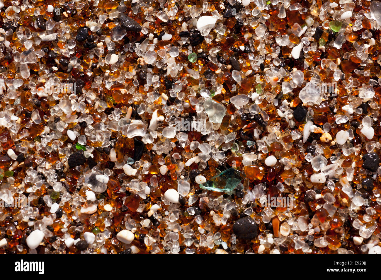 Closeup of glass fragments on beach - Stock Image