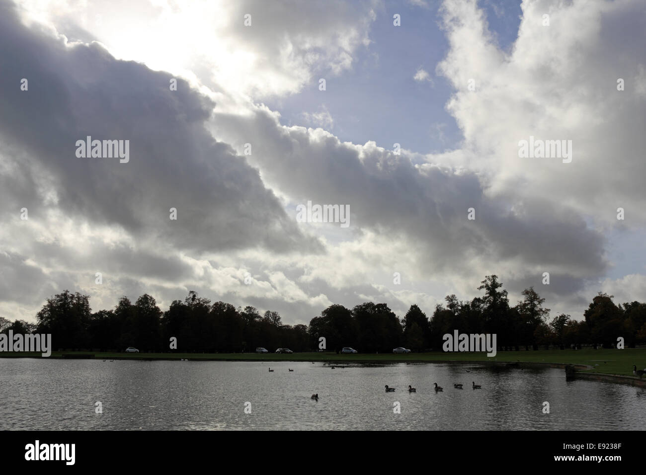Bushy Park, SW London, UK. 17th October 2014. Dramatic cumulus cloud formations over the Diana Fountain pond on - Stock Image