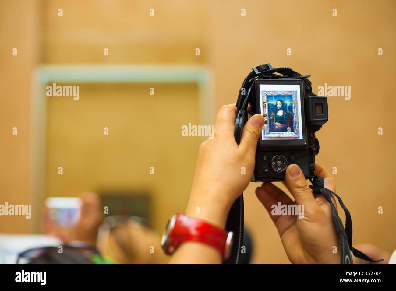 Mona Lisa Camera LCD Louvre - Stock Image