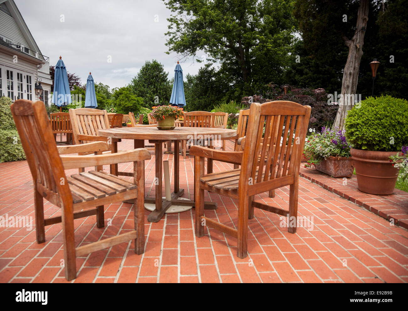 Teak Patio Tables And Chairs On Brick Deck Stock Photo Alamy