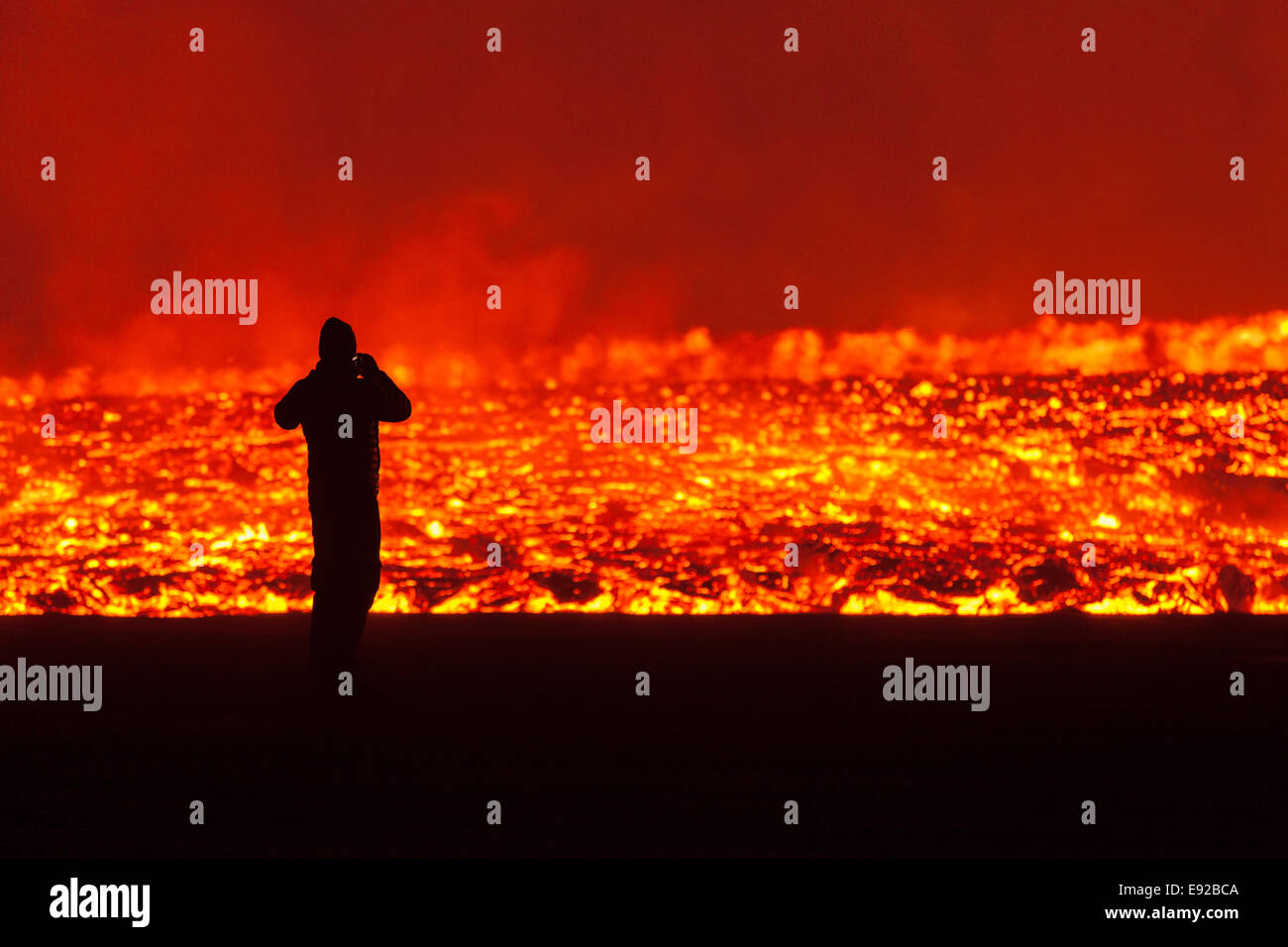 man in front of lava wall - Stock Image