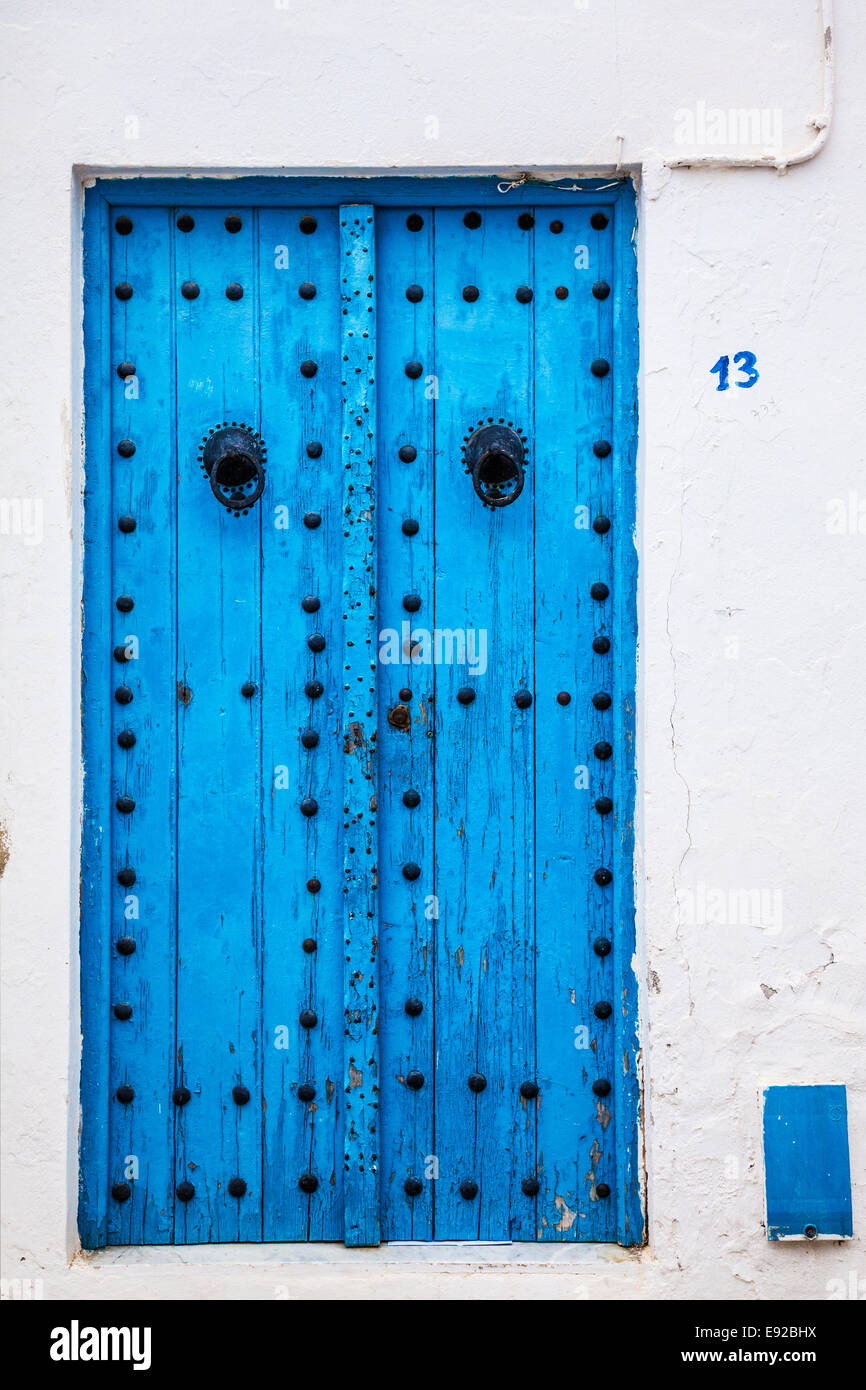 A typical blue, studded wooden door in Sidi Bou Said, Tunisia. Stock Photo