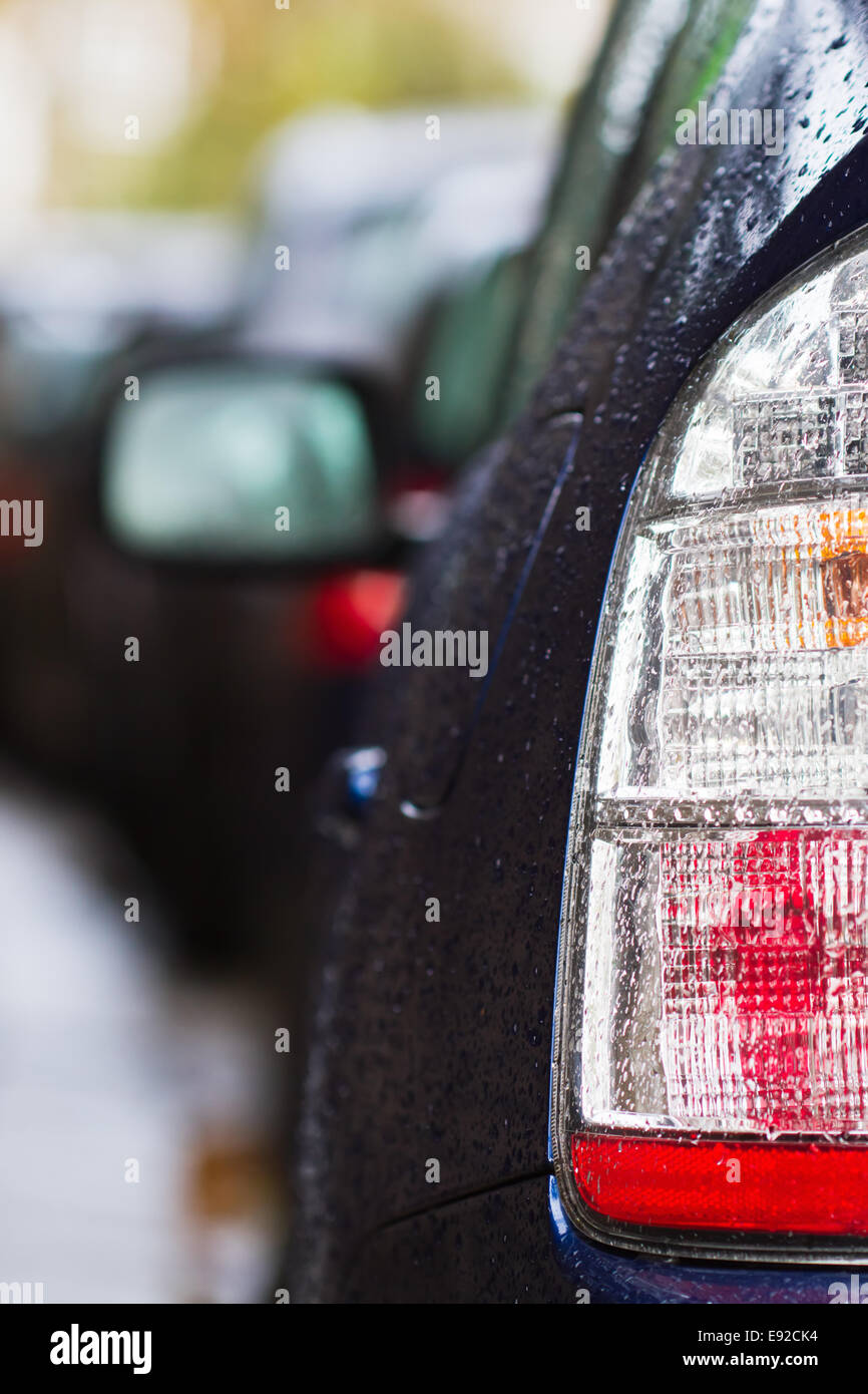 taillight of a car with raindrops Stock Photo
