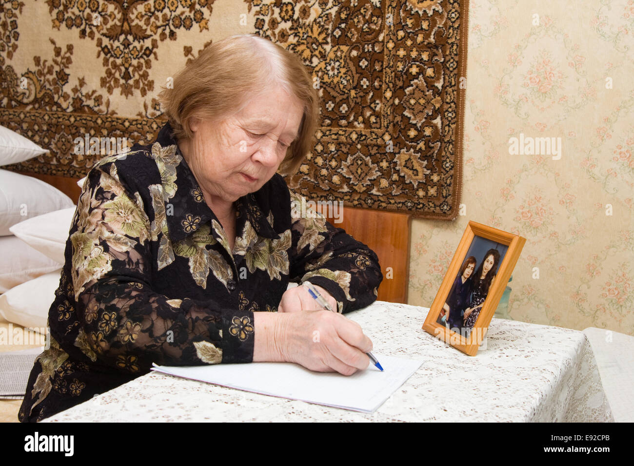 Elderly woman and  letter - Stock Image
