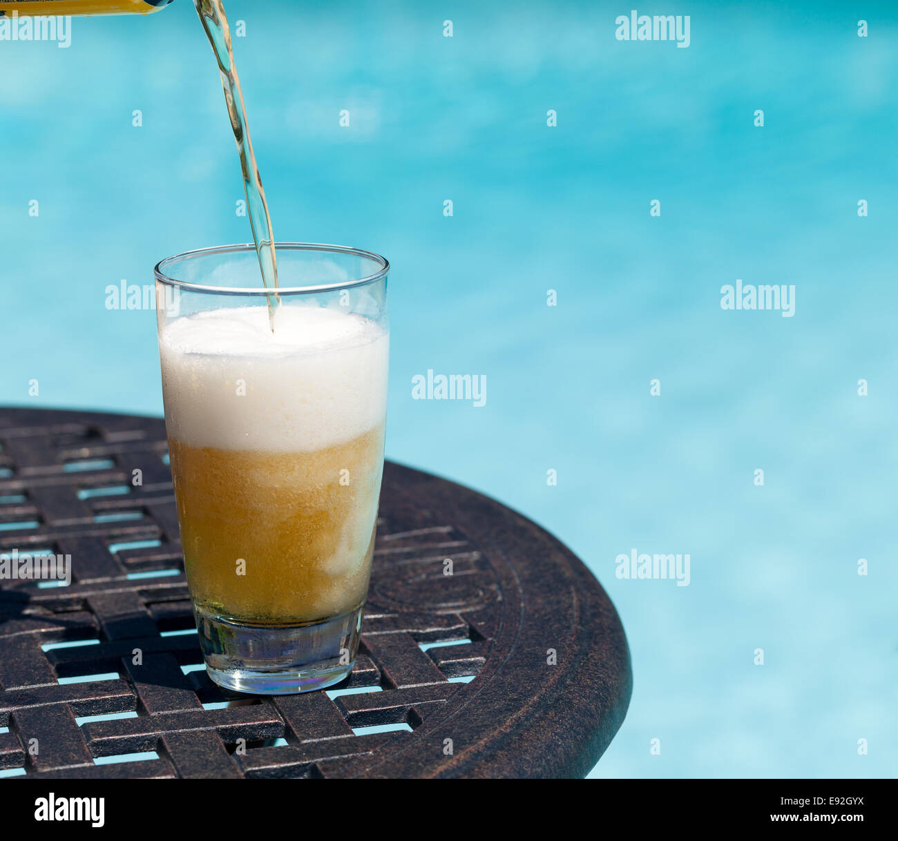 Glass Of Beer On Table By Poolside
