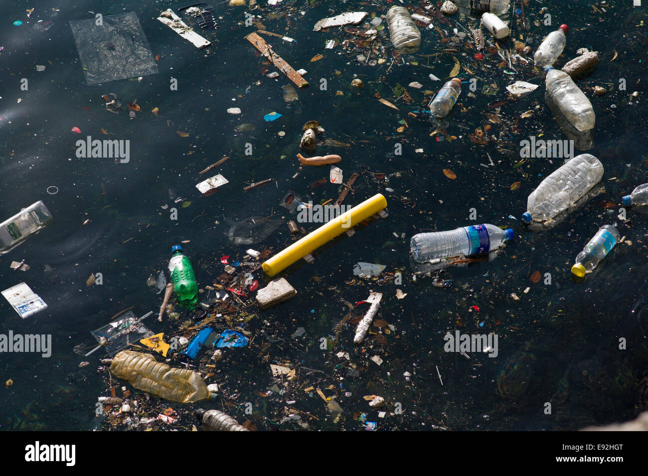 Litter floating on the sea. - Stock Image