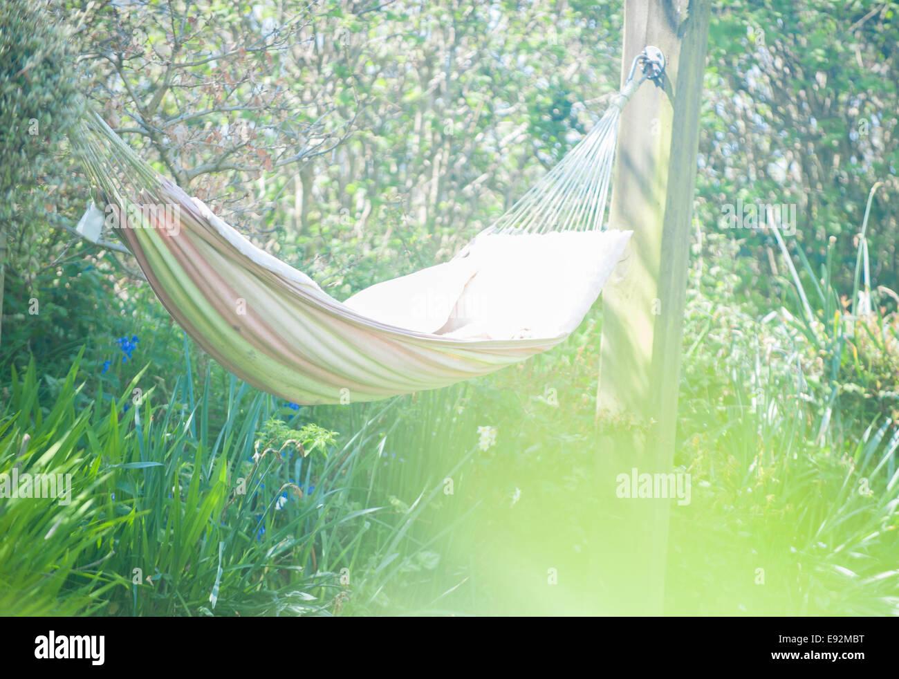 Hammock hanging in garden - Stock Image