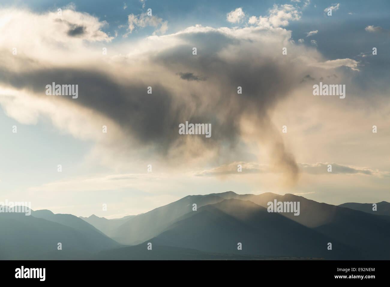 Rain cloud with rain spout over the Colorado mountains, USA - Stock Image