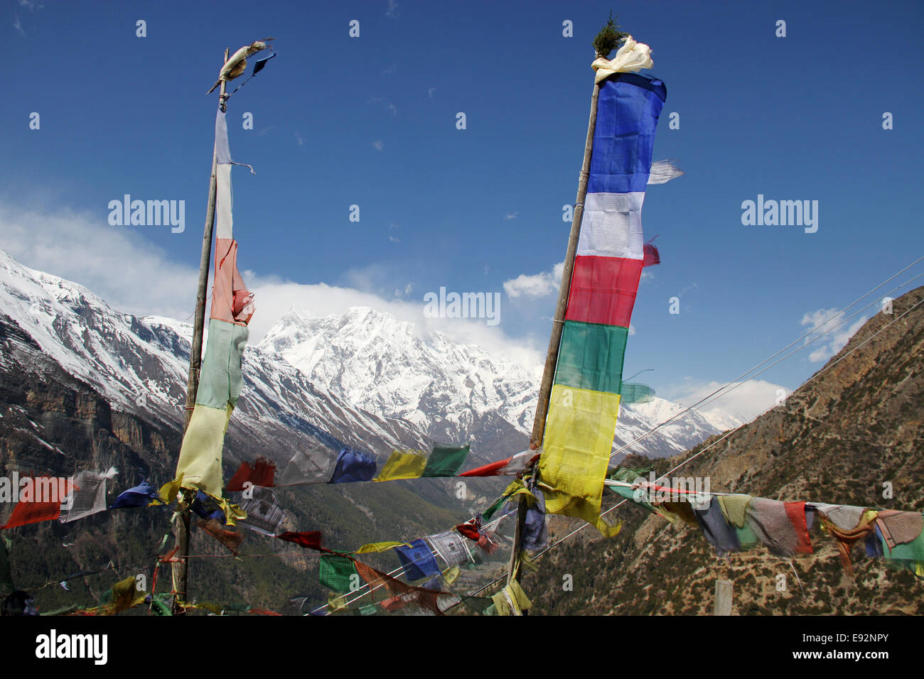 Prayer Flags on the Annapurna Circuit - Stock Image