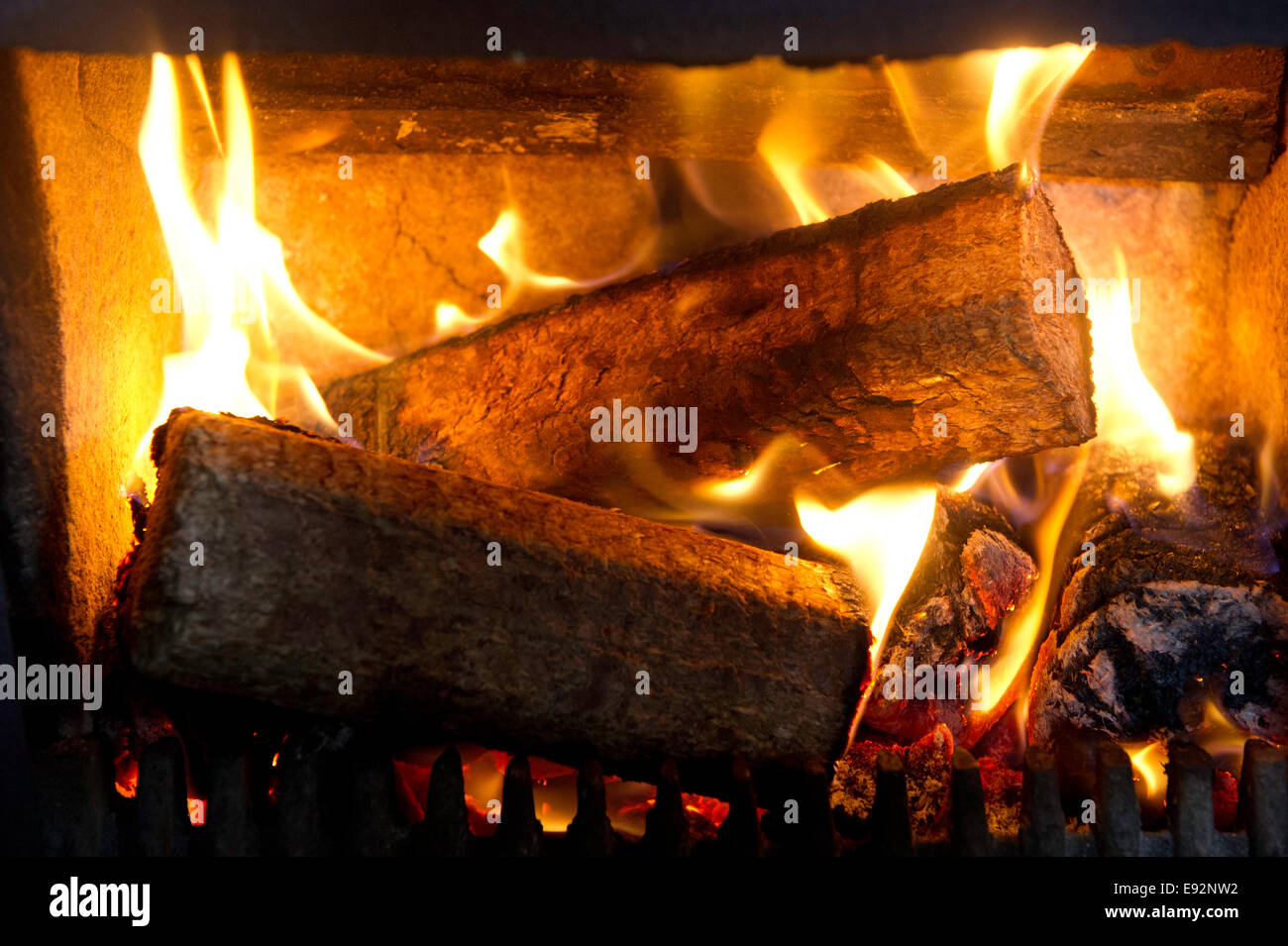 Eco logs in fireplace - Stock Image