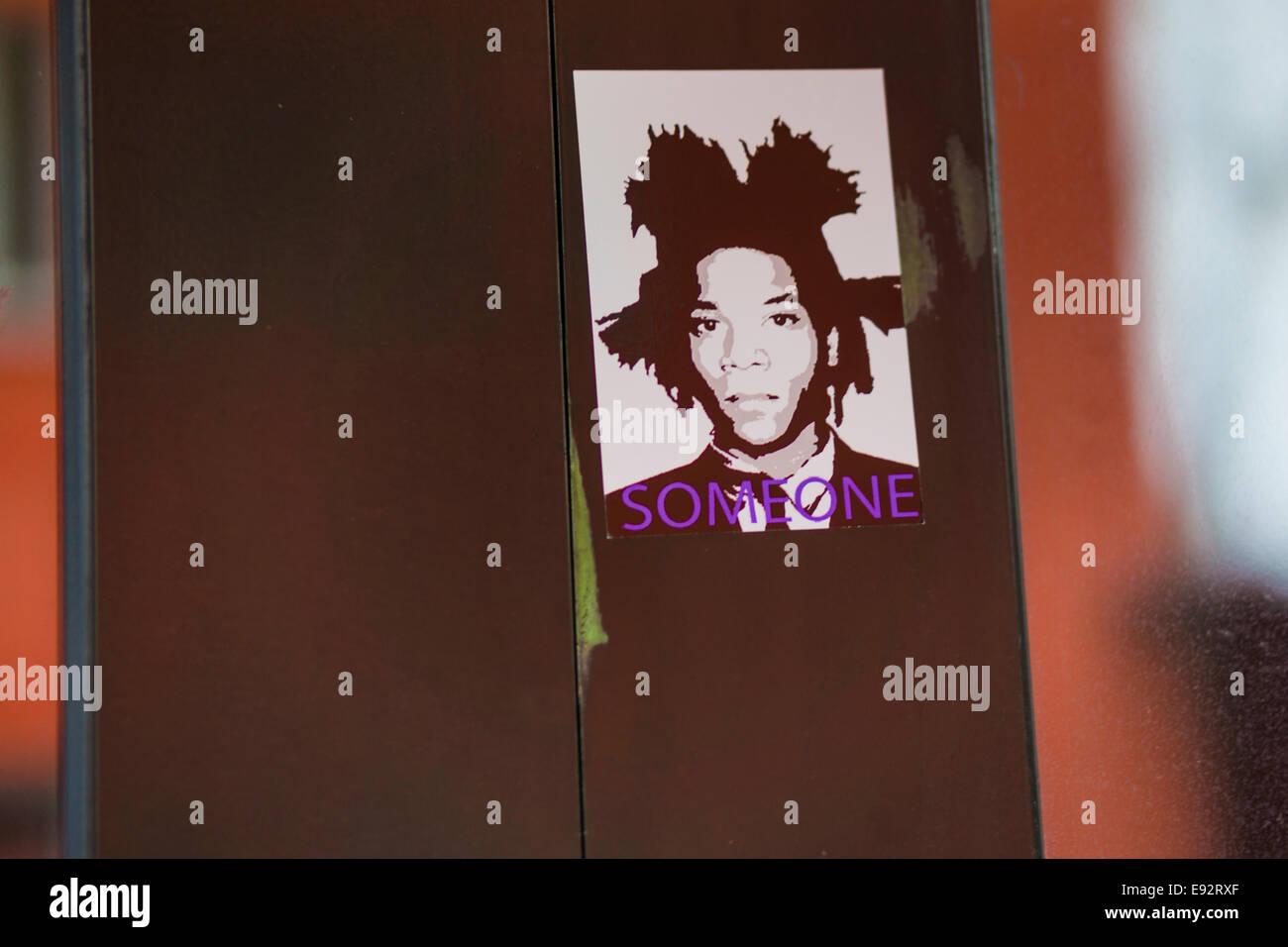 sticker showing a portrait of artist jean-michel basquiat with the caption _someone-, stuttgart, baden-wuerttemberg, - Stock Image