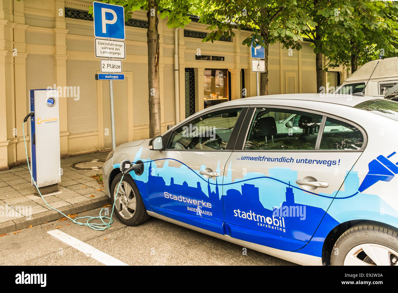 an electric vehicle of the local carsharing enterprise _stadtmobil_ is being charged at a charging station,  baden - Stock Image