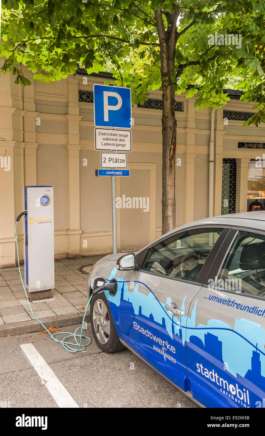 an electric vehicle of the local car sharing enterprise  stadtmobil  is being charged at a charging station,  baden Stock Photo