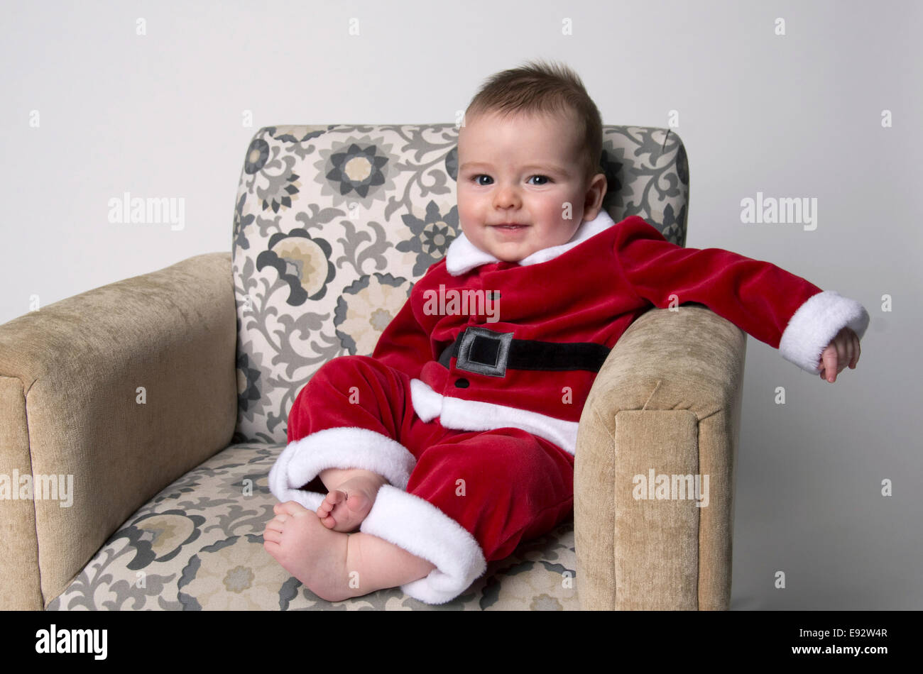 102585f8219f 9 month old baby boy wearing a santa suit