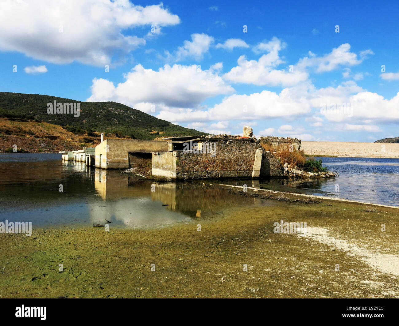 Aposelemi dam with newly formed reservoir flooding the houses of Sfentili village. - Stock Image