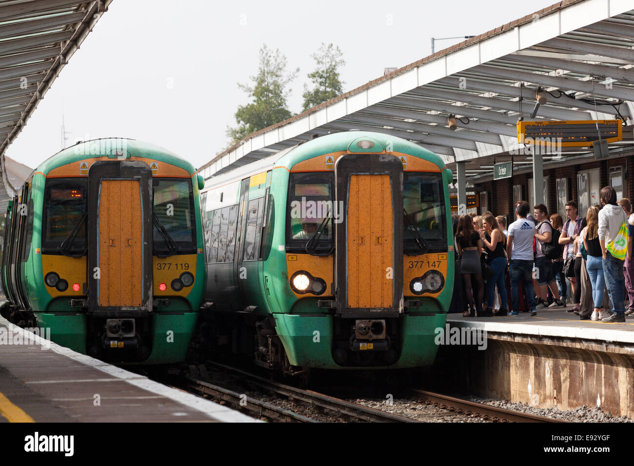 Trains arriving at Chichester station in both directions, West Sussex - Stock Image