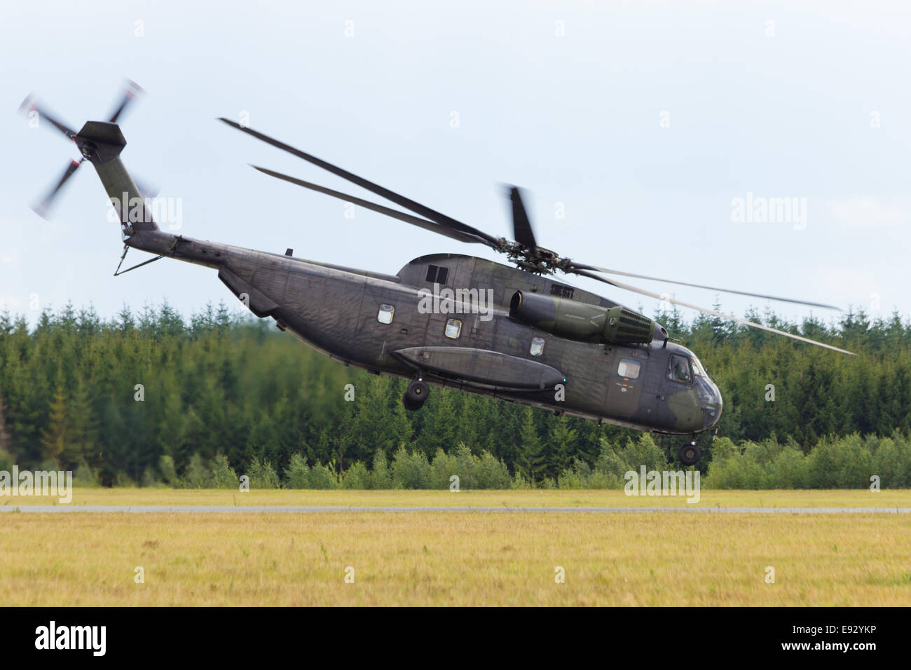 Military transport helicopter take off - Stock Image