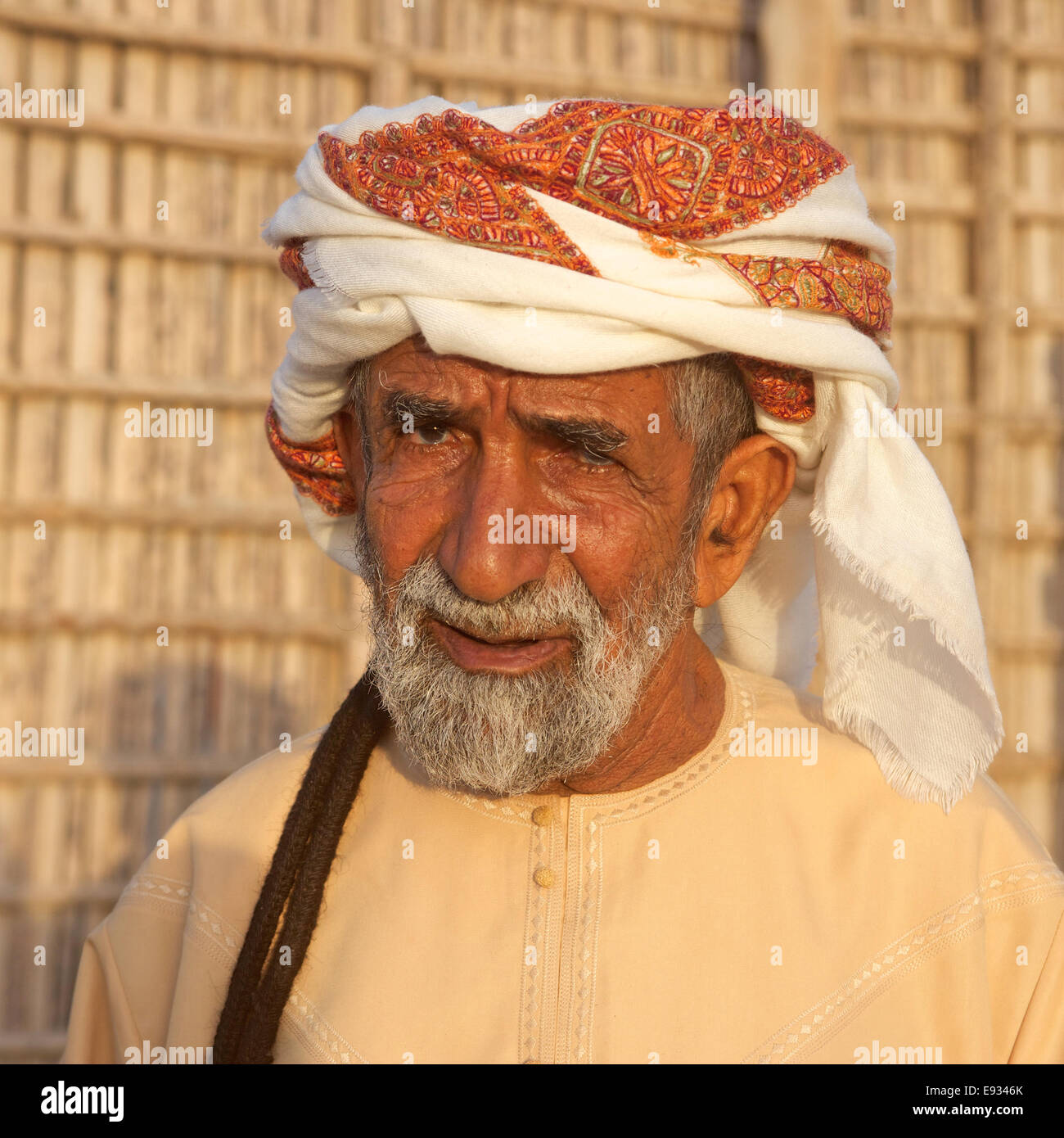 Portrait of an elderly Omani man wearing a traditional headcloth near Muscat in the Sultanate of Oman. Stock Photo