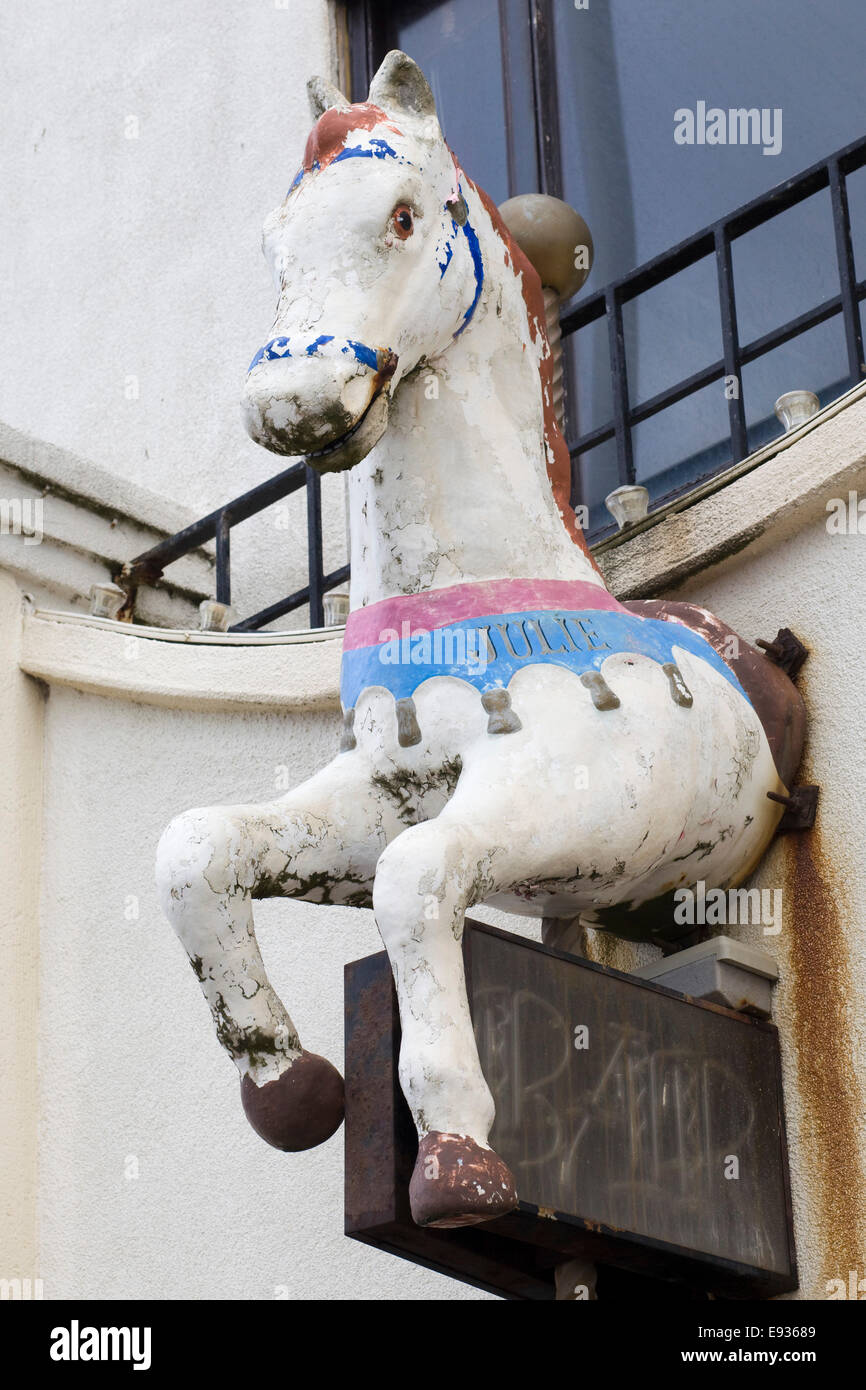 Wooden galloping horse attached to a wall on a closed down bar very run down Blackpool England - Stock Image