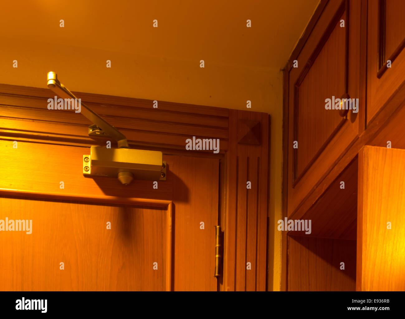 Door closer In the bedroom - Stock Image