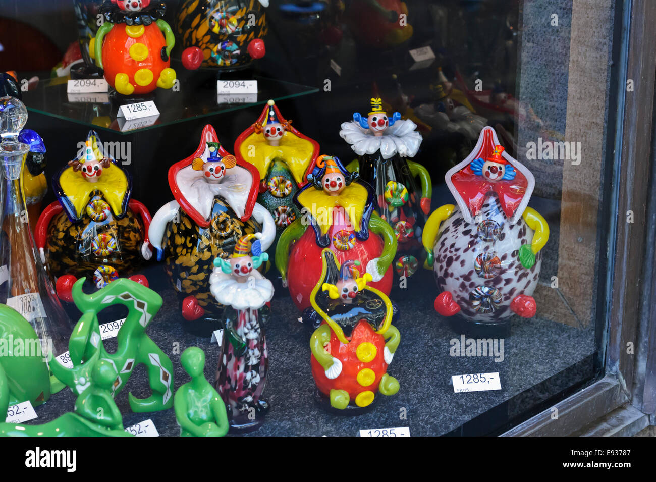 A collection of colourful clown ornaments for sale on