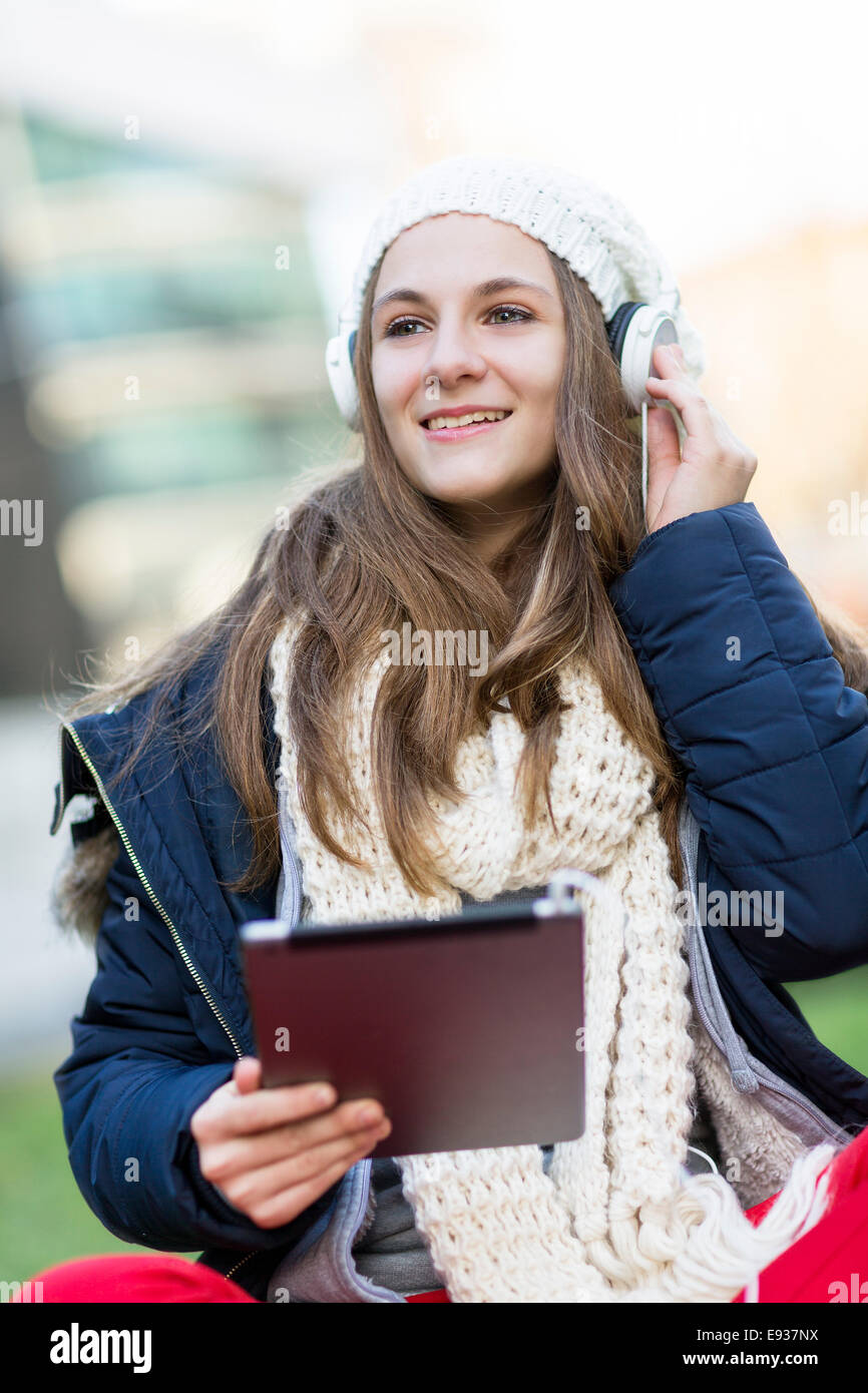 Portrait of teenage girl listening music - Stock Image