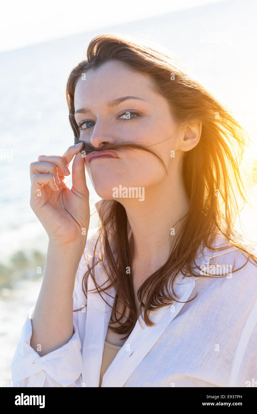Portrait of Woman on the beach - Stock Image