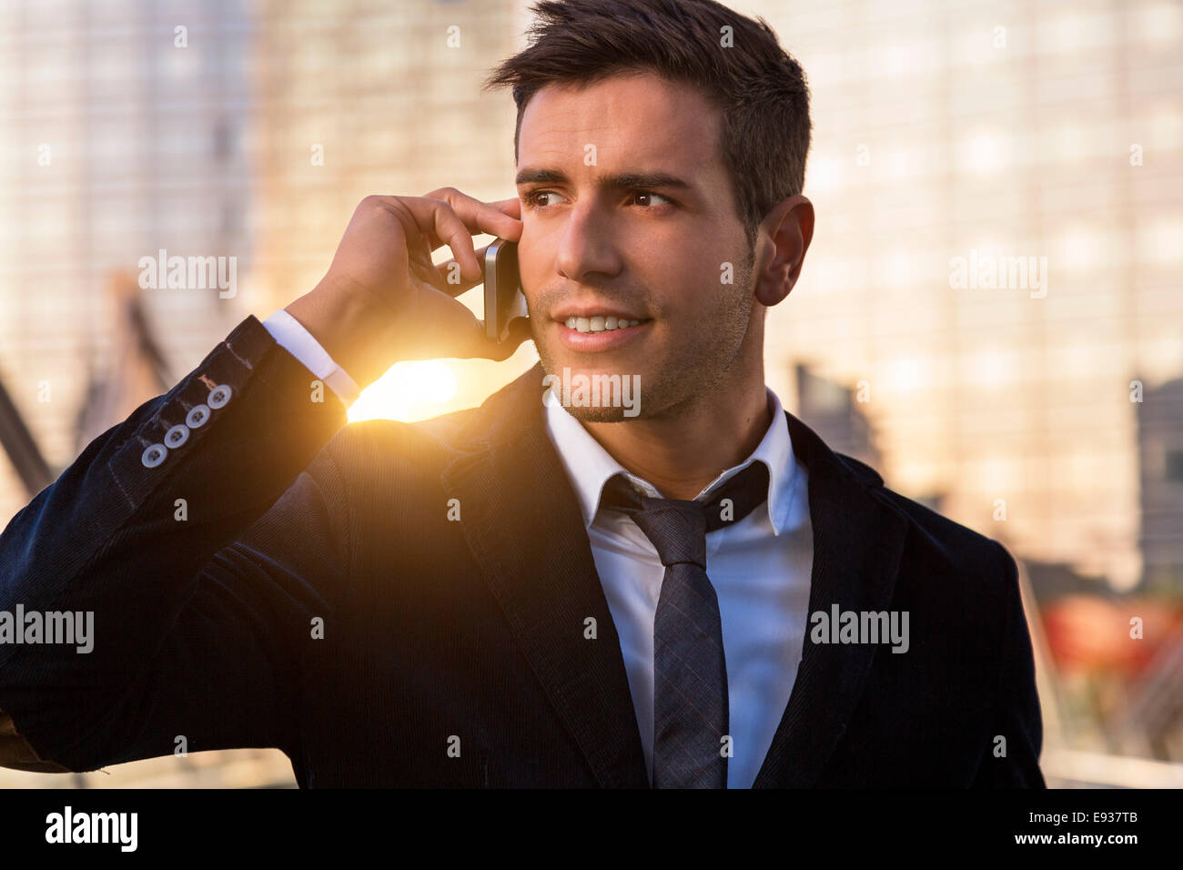 Businessman using mobile phone - Stock Image