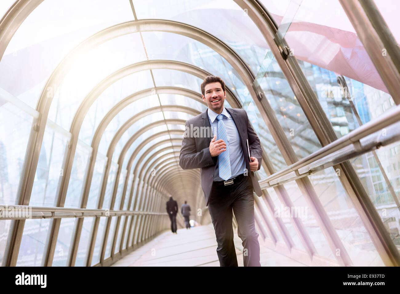 Businessman running - Stock Image