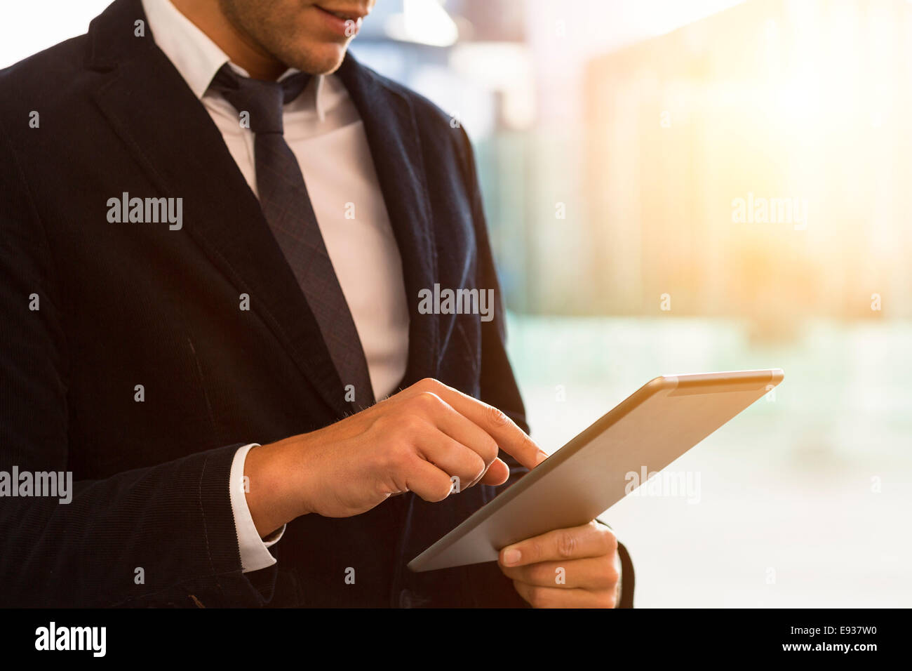 Businessman using Digital Tablet - Stock Image
