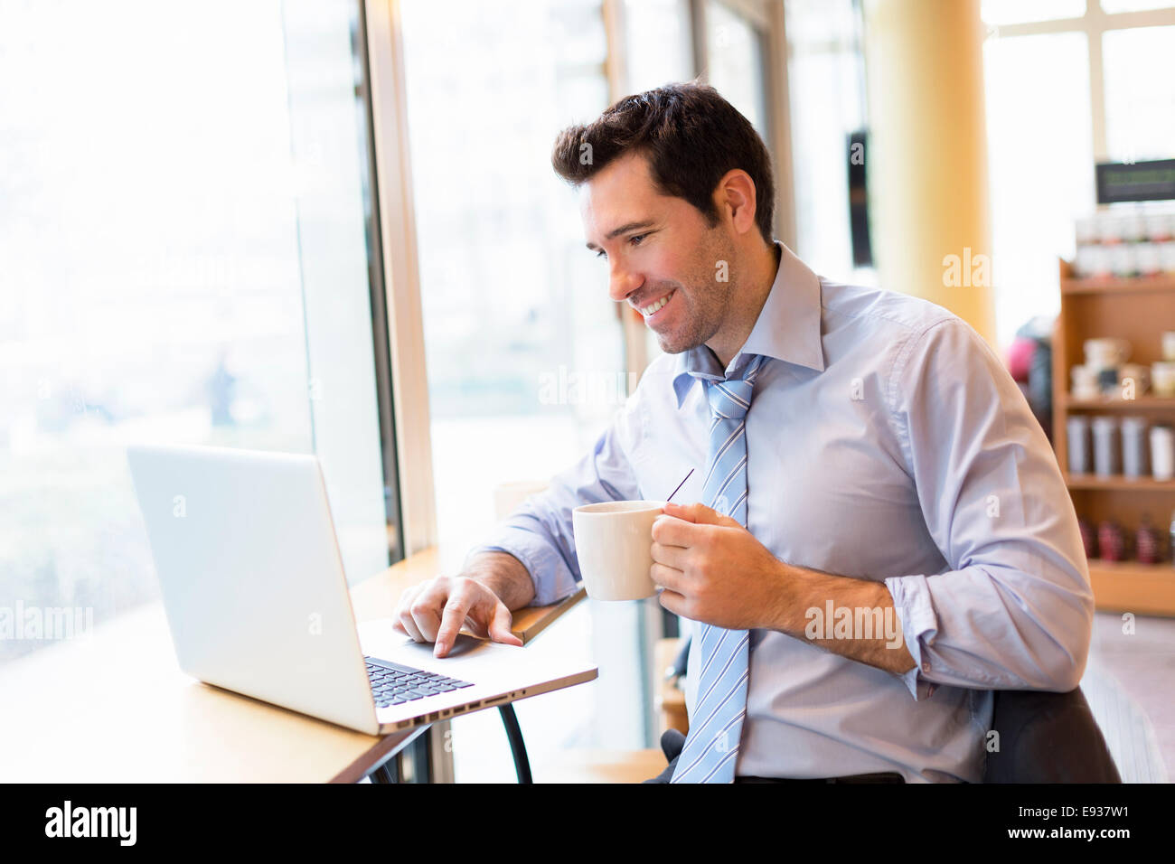 Businessman working in Coffe shop - Stock Image