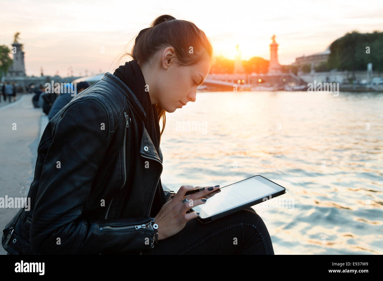 Woman using Digital Tablet - Stock Image