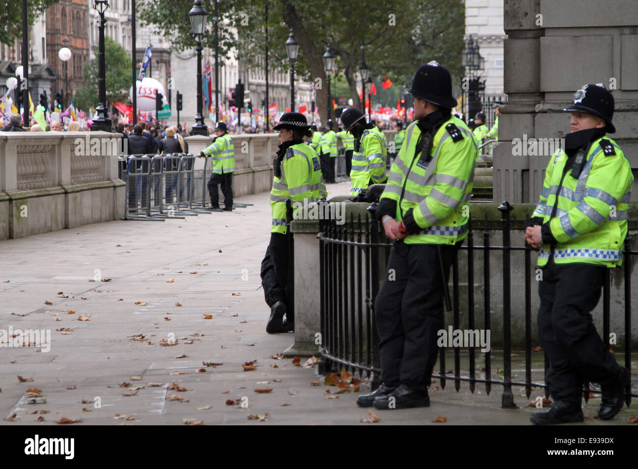Police swatch the TUC march pass along Whitehall in London, UK - Stock Image