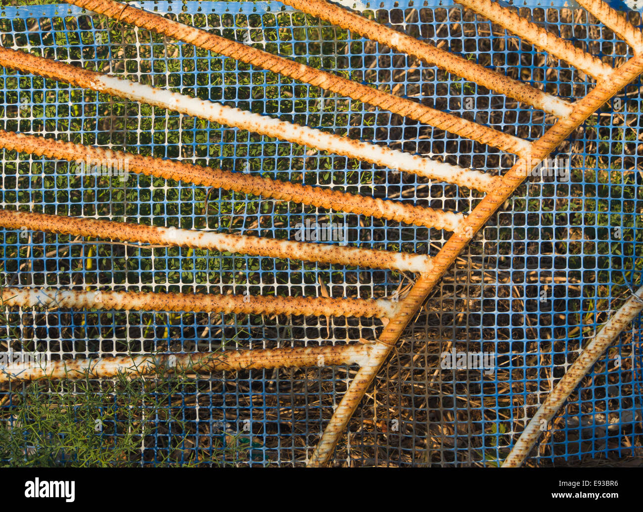 Colorful details of rusty old gate with blue plastic mesh, Samos Greece - Stock Image
